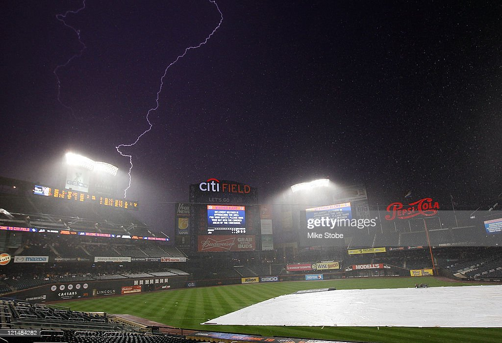 Lightning strikes in the distance during a weather delay before the game between the New York Mets and the Milwaukee Brewers on August 19 2011 at...