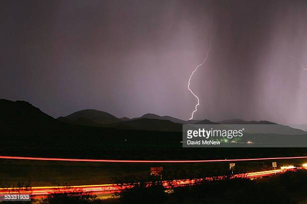 Lightning strikes on August 5 2005 southwest of Barstow California Heavy thunderstorms which could cause flash floods and spark wildfires are...