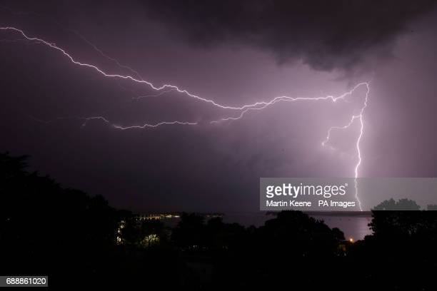 Lightning strikes over Poole harbour in Dorset as thunderstorms swept across parts of south west England after much of the country basked in sunshine...