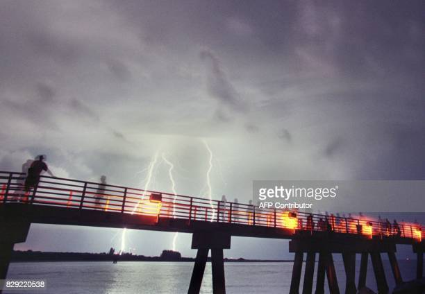 Lightning strikes the area around the Kennedy Space Center FL as viewed from Jetty Park in Cape Canaveral FL during the countdown to launch the space...