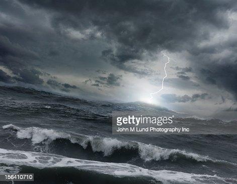 Lightning striking ocean water