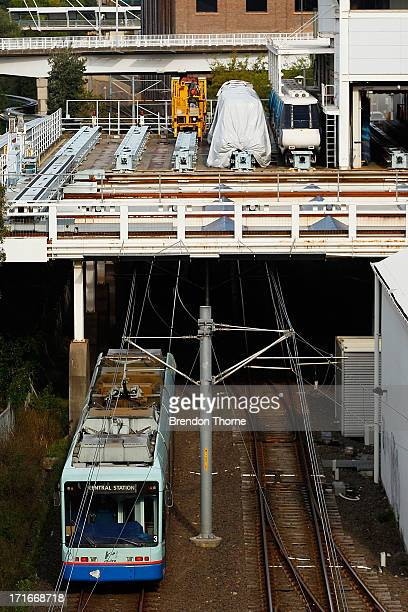 A lightrail train passes underneath a yard of unoperated monorails on June 26 2013 in Sydney Australia The Sydney monorail will complete it's last...