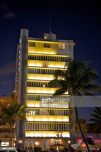 Lights at dusk on Art Deco building
