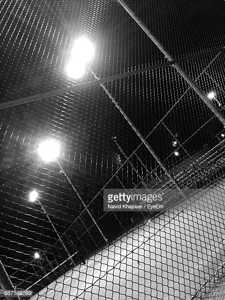Lights Behind Chain Link Fence