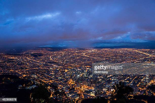 Lights brighten the skyline of Bogota Colombia on Thursday July 10 2014 Colombia's growth in the second quarter was likely close to 5 percent with...