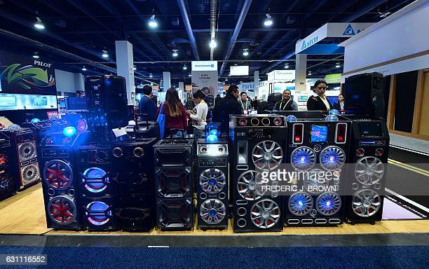 Lights change to the beat of the music from a row of iBastek speakers with Bluetooth USB/microSD and AUX Inputs during the 2017 Consumer Electronic...