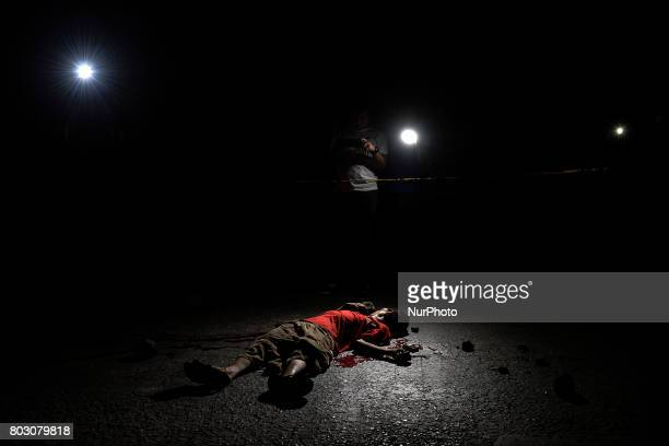 Lights from television cameras illuminate the body of a shooting victim in Quezon city north of Manila Philippines February 10 2017 Drugrelated...