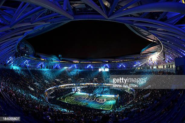 Lights glow in the stadium before Novak Djokovic of Serbia defeated Gael Monfils of France during their men's singles quarterfinals match at the...