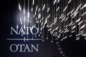 Lights hang in front of a NATO logo during the NATO Summit at Feira Internacional de Lisboa on November 19 2010 in Lisbon Portugal The two day summit...