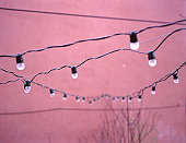 Lights Hanging on Pink Ground