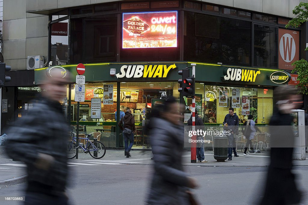 Lights illuminate a Subway fast food restaurant on the corner of street in Brussels, Belgium, on Monday, May 13, 2013. Euro-area data this week will probably reveal economic scars of the sovereign debt crisis confirming that the region is now suffering the longest recession since the single currency's creation. Photographer: Jock Fistick/Bloomberg via Getty Images