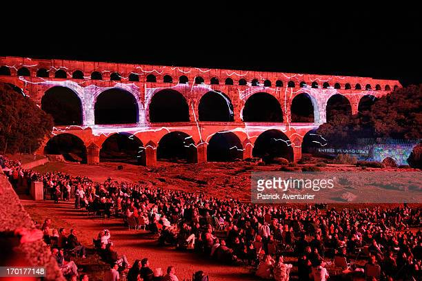 Lights illuminate a view of Le pont Du Gard during the 'Ulysse au Pays Des Merveilles' light show on June 7 2013 in Nimes France At night during the...