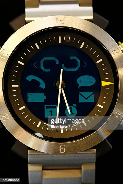 Lights illuminate icons on the face of a Cogito Classic Gun Metal smartwatch produced by ConnecteDevice Ltd designed to connect to an app on the...