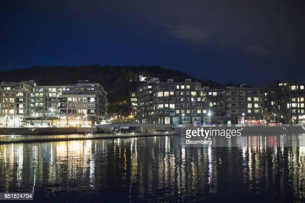 Lights illuminate new residential apartments in the Sorenga district development on the waterside in Oslo Norway on Wednesday Sept 20 2017 Norways...