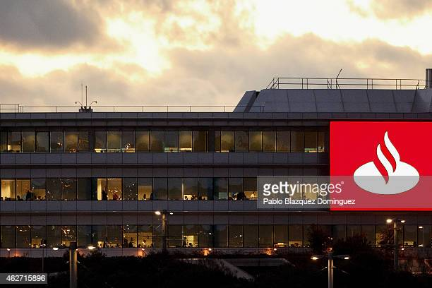 Lights illuminate office floors at dawn inside a Banco Santander's building near the bank's headquarters after a news conference to announce the 2014...