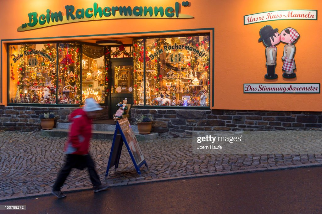 Lights illuminate one of the many shops specializing in hand-made, wooden, Christmas decorations on November 20, 2012 in Dresden, Germany. Seiffen, located in eastern Germany close to the Czech border in the Ore Mountains (Erzgebirge), has an artisinal wooden toy manufacturing tradition dating back to the 18th century. Today local toy producers, many of them family-run, export their hand-made ornaments, nutcrackers, Christmas pyramids, figurines and other toys worldwide.