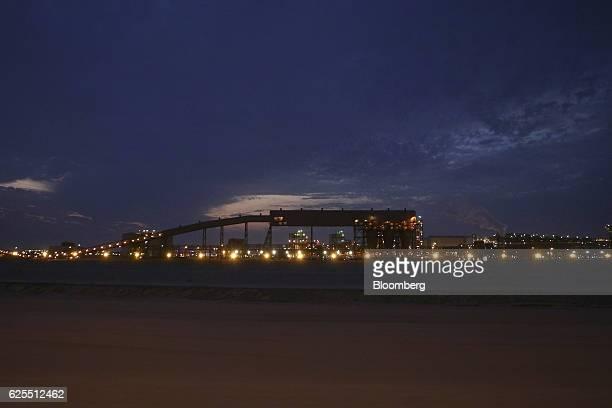 Lights illuminate the conveyor belt system at the aluminium processing plant at the Ras Al Khair Industrial City complex in Ras Al Khair Saudi Arabia...