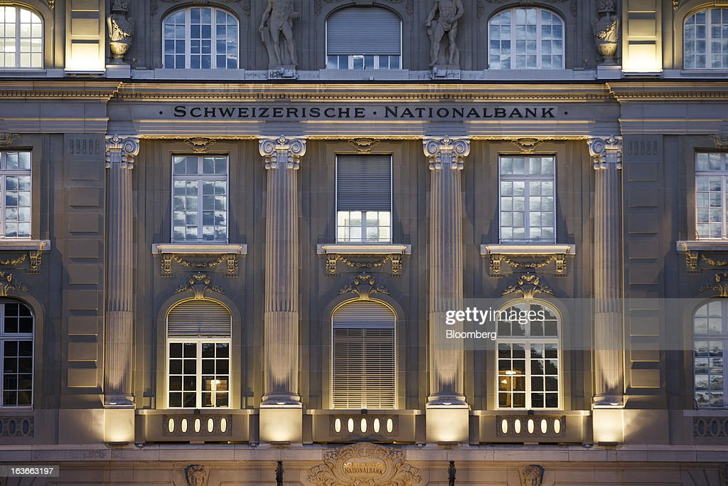 Lights illuminate the front of the Swiss National Bank (SNB), Switzerland's central bank, in Bern, Switzerland, on Tuesday, March 12, 2013. The Swiss central bank pledged to keep up its defense of the franc cap after almost doubling its currency holdings to shield the country from the fallout caused by the euro zone's crisis. Photographer: Valentin Flauraud/Bloomberg via Getty Images