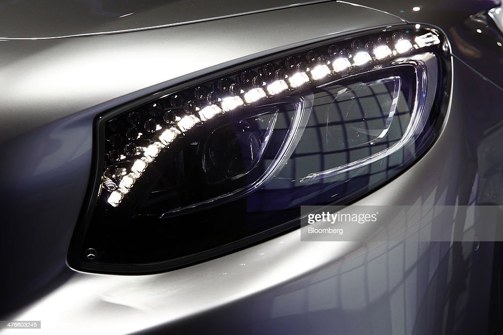 Lights illuminate the headlight of a Mercedes-Benz S-Class coupe automobile, produced by Daimler AG, during its world premiere ahead of the opening day of the 84th Geneva International Motor Show in Geneva, Switzerland, on Monday, March 3, 2014. The International Geneva Motor Show will run from Mar. 4, and showcase the latest models from the world's top automakers. Photographer: Gianluca Colla/Bloomberg via Getty Images