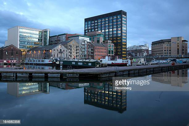 Lights illuminate the office space at Google Inc's European headquarters center viewed from the Grand Canal Dock in Dublin Ireland on Friday March 15...