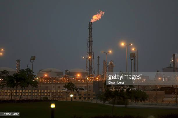 Lights illuminate the phosphate processing plant as a flame burns from a chimney at the Ras Al Khair Industrial City operated by the Saudi Arabian...