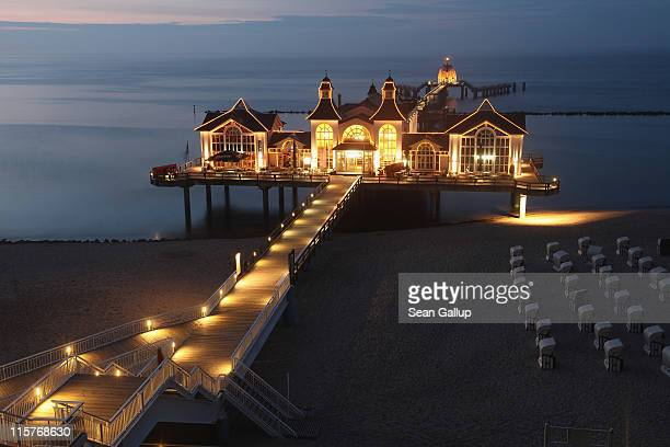 Lights illuminate the picturesque pier on June 7 2011 on Ruegen Island at Sellin Germany Ruegen Island located off the north German coast in the...