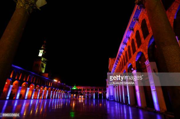 Lights illuminate the Umayyad Mosque in the Old City of the Syrian capital Damascus on June 14 2017 / AFP PHOTO / Louai Beshara