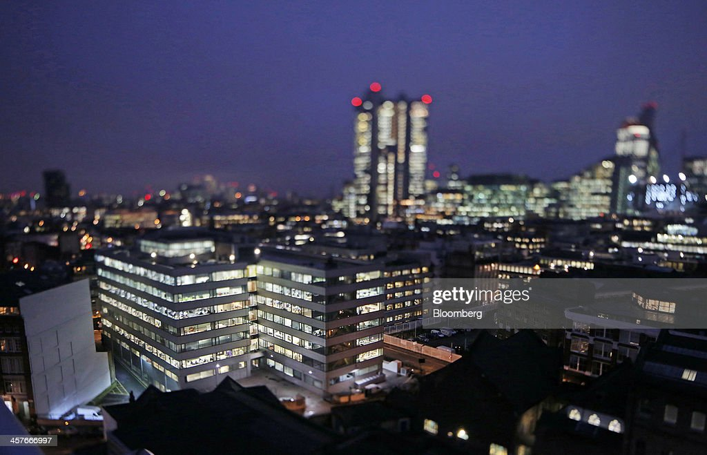 Lights illuminate the windows of an office block as it stands in the area known as London's Tech City, in this image taken with a tilt-shift lens near Old Street roundabout, in London, U.K., on Tuesday, Dec. 17, 2013. The U.K government last year pledged 50 million pounds for a new London startup incubator, and hired ex-Facebook Inc. executive Joanna Shields to promote Tech City, with Google Inc., Amazon.com Inc., and Cisco Systems Inc. all having taken space in the area or planning to do so. Photographer: Chris Ratcliffe/Bloomberg via Getty Images