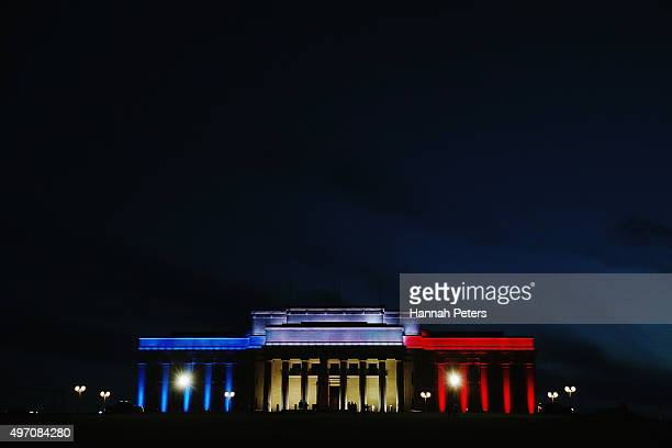 Lights in the colours of the French flag light up the Auckland Museum to remember victims of the Paris attacks on November 14 2015 in Auckland New...