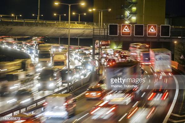 Lights of cars that are standing in a traffic jam on a motorway autobahn at night on November 7 in Berlin Germany Daily rushhour traffic