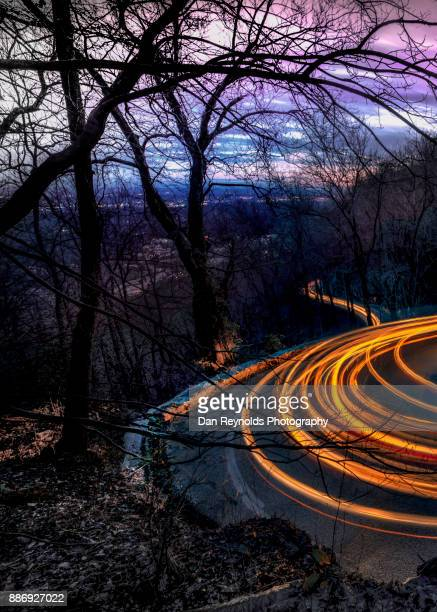 Lights of Vehicles on Mountain Road at Night