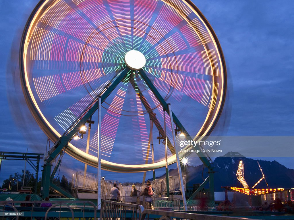 Lights on a Ferris wheel streak in a long-exposure photograph at the Alaska State Fair, August 29, 2012, in Palmer, Alaska. The fair continues through the Labor Day weekend.