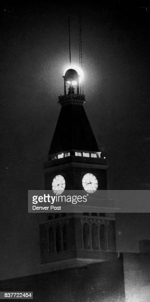 Lights On Even the moon behind the cupola joined in as lights went back on Monday night in the old Daniels and Fisher Tower and clock in downtown...