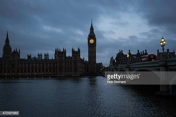 Lights shine on the bridge towards Big Ben and The Houses of Parliament on May 7 2015 in London England The United Kingdom is going to the polls to...