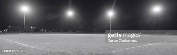 Lights shining on ball park, night (B&W)
