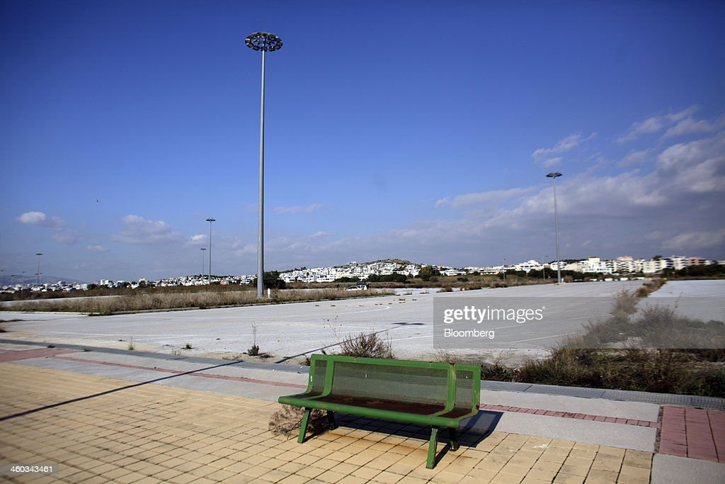 Lights stand on the abandoned tarmac area at the former Athens International Airport in the Hellenikon district of Athens, Greece, on Friday, Dec. 3, 2014. Hellenikon is the largest of Greece's land development projects, three times the size of the Principality of Monaco. Photographer: Kostas Tsironis/Bloomberg via Getty Images