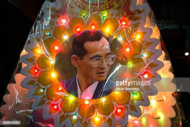Lights surround a portrait of Thailand's King Bhumibol Adulyadej as the celebration for the King's 88th birthday begins on December 4 2015 in Bangkok...