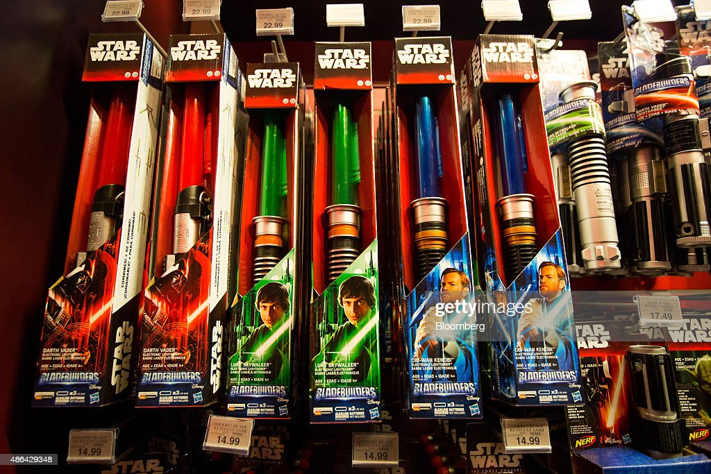 Lightsabers from the Walt Disney Co Star Wars movie franchise sit on display during the 'Force Friday' event at a Toys R Us Inc Store in New York US...