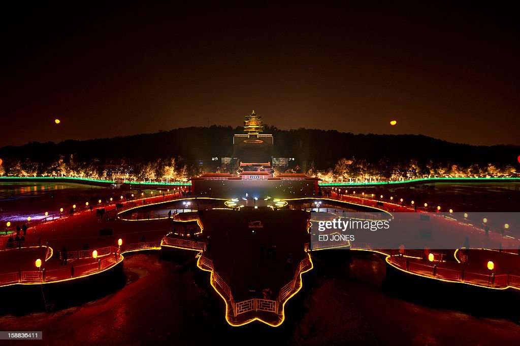 A lightshow illuminates the Summer Palace during a new year count-down event in Beijing on December 31, 2013. AFP PHOTO / Ed Jones