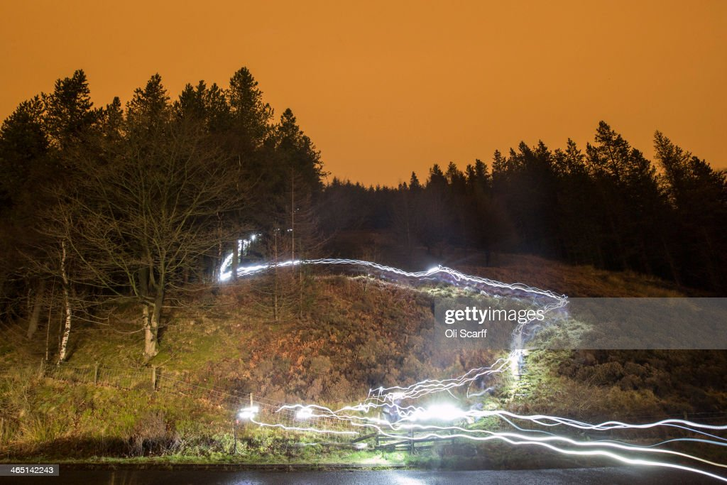 Light-trails illuminate from head torches worn by competitors taking part in the 'Marmot Dark Mountains' night-time adventure race illuminate the landscape on January 26, 2014 in Glossop, England. The mountain marathon race began at 7pm on the evening of the 25th and required participants to navigate and run between a series of checkpoints throughout the Peak District National Park. The event is split into several classes based on competitor performance with each course traversing the high moorland areas surrounding Kinder Scout. The 'Elite' category runners raced from dusk-to-dawn, covering 55.5km and gaining 2,635m of height.