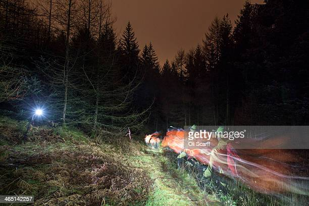 Lighttrails illuminate from head torches worn by competitors taking part in the 'Marmot Dark Mountains' nighttime adventure race illuminate the...