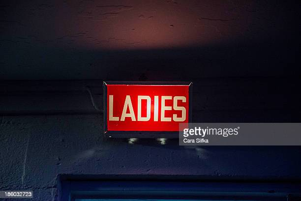 Light-up retro ladies bathroom sign