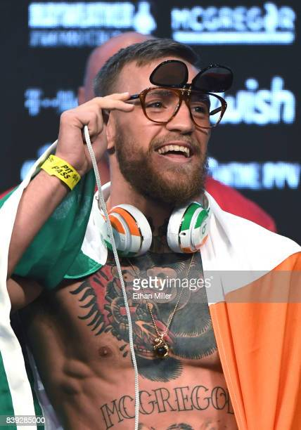 UFC lightweight champion Conor McGregor arrives at his official weighin at TMobile Arena on August 25 2017 in Las Vegas Nevada McGregor will meet...