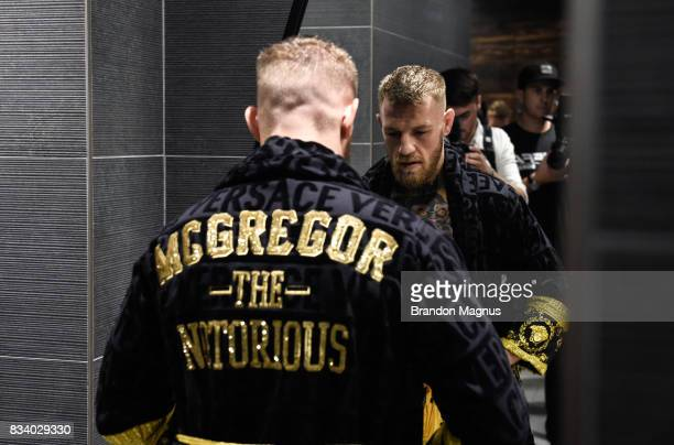 UFC lightweight champion Conor McGregor changes in the locker room before the media workout at the UFC Performance Institute on August 11 2017 in Las...