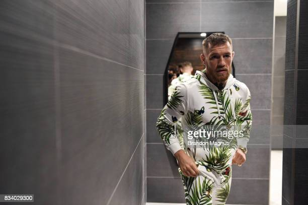 UFC lightweight champion Conor McGregor enters the locker room before the media workout at the UFC Performance Institute on August 11 2017 in Las...