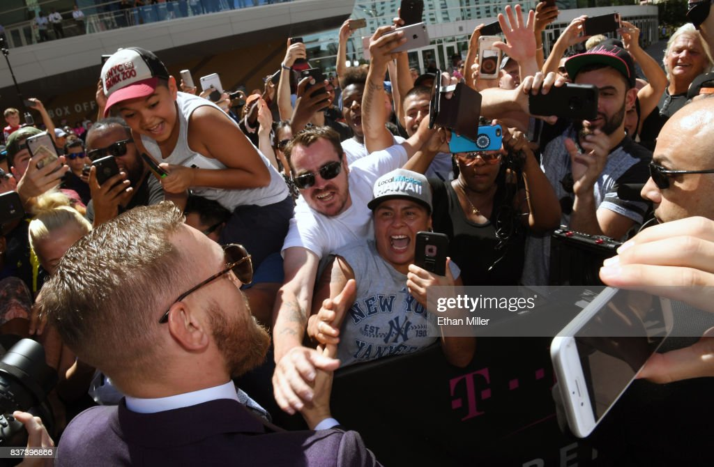UFC lightweight champion Conor McGregor greets fans as he arrives at Toshiba Plaza on August 22, 2017 in Las Vegas, Nevada. McGregor will fight Floyd Mayweather Jr. in a super welterweight boxing match at T-Mobile Arena on August 26 in Las Vegas.