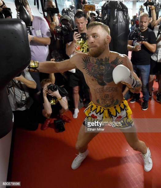 UFC lightweight champion Conor McGregor hits an uppercut bag during a media workout at the UFC Performance Institute on August 11 2017 in Las Vegas...