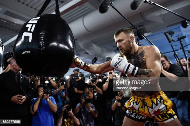 UFC lightweight champion Conor McGregor hits the heavy bag during a media workout at the UFC Performance Institute on August 11 2017 in Las Vegas...