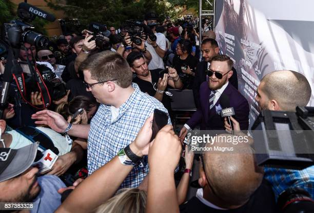 UFC lightweight champion Conor McGregor speaks to the media at the Toshiba Plaza outside TMobile Arena ahead of their fight on August 22 2017 in Las...