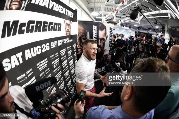 UFC lightweight champion Conor McGregor speaks to the media during a media workout at the UFC Performance Institute on August 11 2017 in Las Vegas...